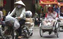 A photo of Asian rickshaws in a busy street