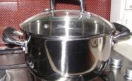 A saucepan with a lid sitting on a stove